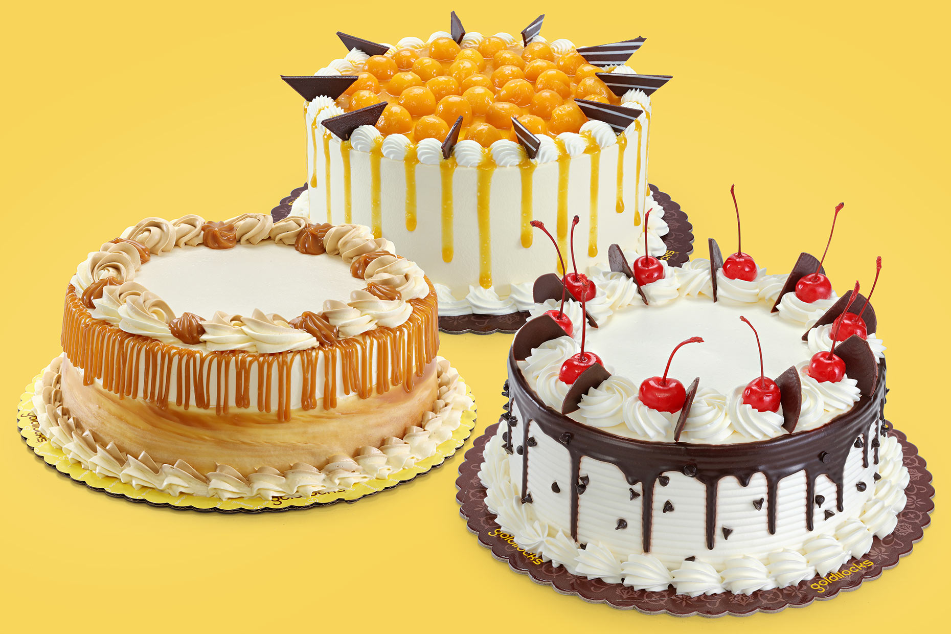 cakes compsited on yellow background